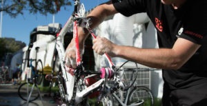Cyclist washing his bike