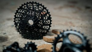 Bike gears sitting on the ground.