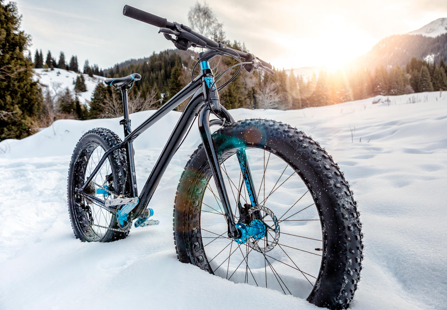 Bicycle sitting in the snow.